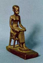 Egyptian 26th Dynasty - Seated statue of Imhotep (fl.c.2980 BC) holding an open papyrus scroll, Late Period