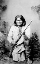 American Photographer - Geronimo holding a rifle, 1884