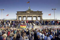 Norbert Michalke (F1 Online) - Fall of the Berlin Wall: people from East and West Berlin climbing on the Wall at the Brandenburg Gate, Berlin, Germany