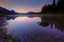 First Light (F1 Online) - Early morning on a fog covered Maligne Lake in Jasper National Park in the Canadian Rockies during the autumn, Alberta