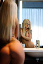 Tobias Trapp (F1 Online) - Naked woman with tattoo standing in bathroom