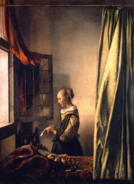 Girl reading a letter at an open window of artist Jan Vermeer van Delft as framed image