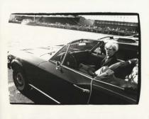 Andy Warhol - Andy Warhol in Convertible, c. 1985