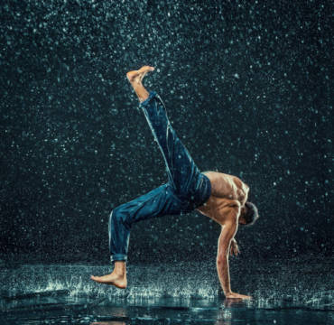 The male break dancer in water. of artist Volodymyr Melnyk as framed image
