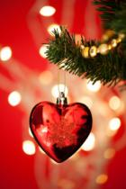Andriy Popov - Heart Shape Bauble On Christmas Tree