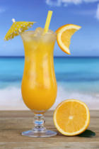 Markus Mainka - Orange juice fruits cocktail on the beach