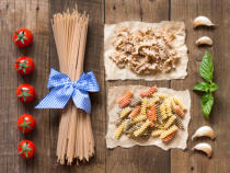 Ekaterina Fedotova - Pasta, tomatoes,garlic and basil on wooden background